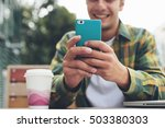 Smiling Man With Smartphone In...