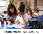 primary school teacher helping... | Shutterstock . vector #503425873