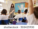 kids raising hands in a primary ... | Shutterstock . vector #503425930