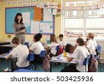 teacher with computer in front... | Shutterstock . vector #503425936