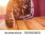 businessman showing thumbs up | Shutterstock . vector #503502853