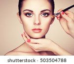 makeup artist applies skintone. ... | Shutterstock . vector #503504788