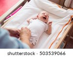 unrecognizable father changing... | Shutterstock . vector #503539066