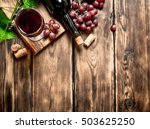 red wine with a vine branch. on ... | Shutterstock . vector #503625250