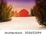 Red Barn In The Snow At Sunset