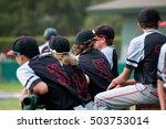 Youth Baseball Players Behind...