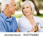 happy senior couple looking at... | Shutterstock . vector #503796880