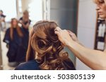 hair stylist makes the bride... | Shutterstock . vector #503805139