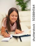 girl writing in a notebook... | Shutterstock . vector #503884564