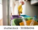 woman putting banana peel in... | Shutterstock . vector #503886046