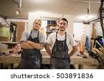 two carpenters look at the... | Shutterstock . vector #503891836