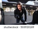 furious criminal man in hoodie... | Shutterstock . vector #503920189