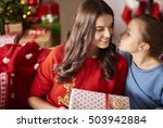 girl kissing her mom at... | Shutterstock . vector #503942884
