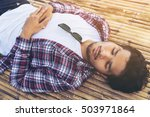 young man sleep on bamboo bed.   Shutterstock . vector #503971864