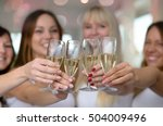 four young women toasting with... | Shutterstock . vector #504009496