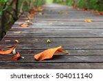 leaves drop on a wooden bridge   Shutterstock . vector #504011140