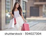 Young Happy Woman With Shoppin...