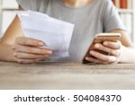 woman hands with bills and... | Shutterstock . vector #504084370