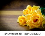 photo of three yellow roses on... | Shutterstock . vector #504085330