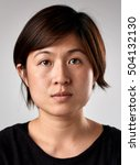 Stock photo portrait of real chinese asian woman with no expression id or passport photo full collection of 504132130