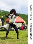 Small photo of ADYGEA, RUSSIA - JULY 25 2015: Adyghe guy in Circassian national costumes dancing on ethnic festival in the mountains of Adygea.
