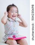little girl playing tablet... | Shutterstock . vector #504230698