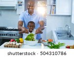 father and son preparing food... | Shutterstock . vector #504310786