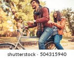 young couple riding bicycle... | Shutterstock . vector #504315940