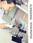 girl chemist working in a... | Shutterstock . vector #504350473