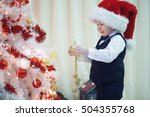 the boy hangs up a toy on a new ... | Shutterstock . vector #504355768