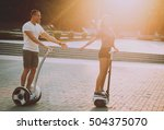 young couple driving on segway... | Shutterstock . vector #504375070