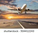 a passenger plane in flight.... | Shutterstock . vector #504412243