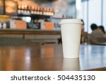 Small photo of hot coffee cup in coffee shop