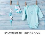 baby clothes and word baby on a ... | Shutterstock . vector #504487723