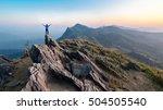 winner man on peak of rocks... | Shutterstock . vector #504505540