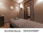 a massage room with bed  brown... | Shutterstock . vector #504549889