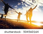 group of friends runs to sunset.... | Shutterstock . vector #504560164
