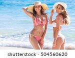 happy smiling female friends in ...   Shutterstock . vector #504560620