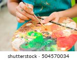beautiful young girl draws a... | Shutterstock . vector #504570034