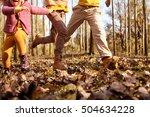 Three Children Running In The...