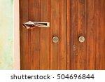 Old Wooden Door With Newspaper...