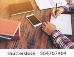businessman working on a desk.... | Shutterstock . vector #504707404