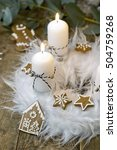 Small photo of white advent wreath with decoration, two candles