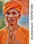 Small photo of Mayapur - March 16, 2016: Indian monk attending Gaura Purnima festival in Mayapur