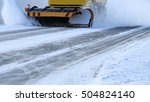 Snowplow Removes Snow Off Icy...