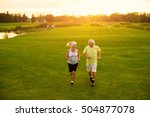 elderly couple is jogging.... | Shutterstock . vector #504877078