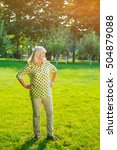 Small photo of Woman standing on grass. Elderly female smiling. Admiring the views of nature. Most picturesque place for photos.