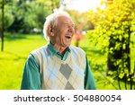 Senior Man Laughing. Elderly...