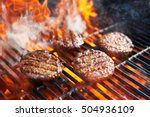 cooking burgers on hot grill... | Shutterstock . vector #504936109