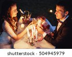 couple on a romantic picnic by... | Shutterstock . vector #504945979